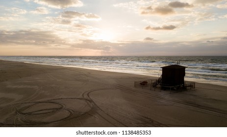 aerial view of baywatch house on empty sandy beach on sunset, Ashdod, Israel