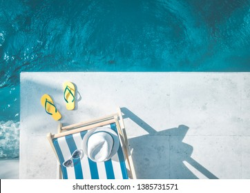 Aerial view of beach accessories next to the swimming pool