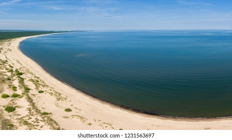 Aerial view of beach by the blue Baltic sea, near Vistula river mouth