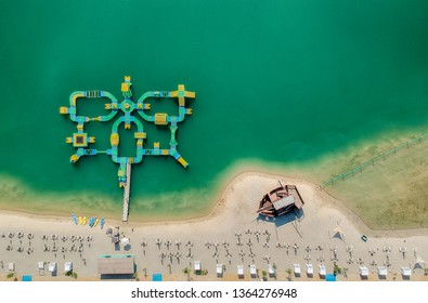 Aerial view of a beach and green water