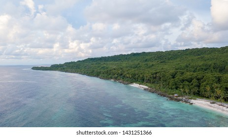 Aerial view of beach and hills with nice sky and blue ocean  in Wakatobi, Indonesia, Asia