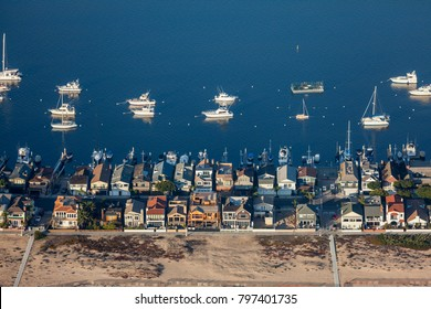 Aerial view of beach homes and boats in Newport Beach, California