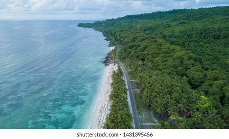 Aerial view of the beach near highway with nice sky and blue ocean in Wakatobi, Indonesia, Asia