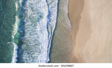 Aerial view of beach ocean waves and sand on Gold Coast beach