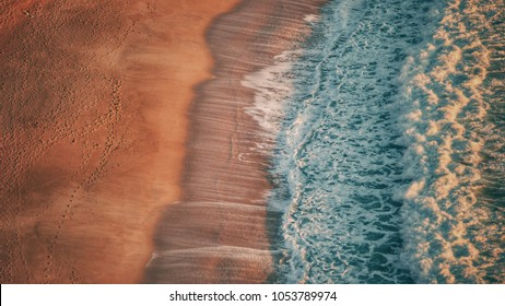 Aerial view of the beach only sand and water