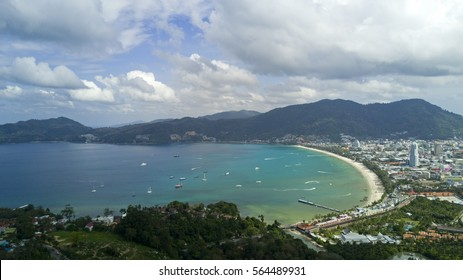Aerial view: The beach and resort town on the beautiful seacoast from birds eye view, Patong, Phuket island, Thailand