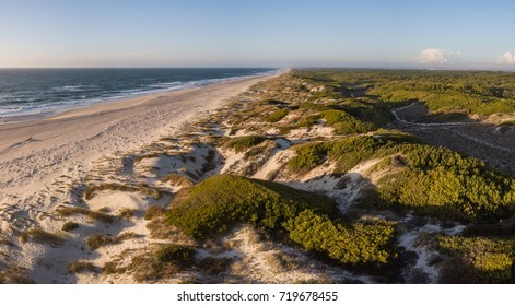 Aerial view of beach and sand dunes at sunset in Murtosa, Aveiro - Portugal. Aerial view.