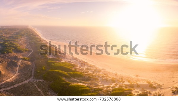 Aerial view of beach and sand dunes at sunset in Murtosa, Aveiro - Portugal. South view.