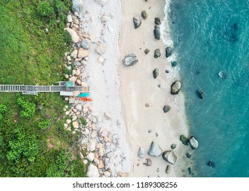 Aerial view of a beach with sand and rocks on the Long Island Sound along the North Fork of Long Island