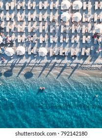 Aerial view of a beach with sunbeds. Took in mid summer on a sunny hot day.