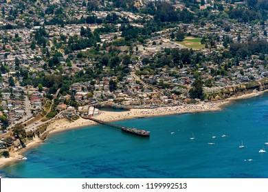 The aerial view of the beach with tourists in the city of Capitola in Northern California, close to the city of Santa Cruz.