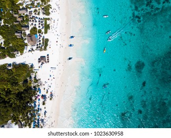 Aerial view of a beach in Tulum Mexico on a sunny day