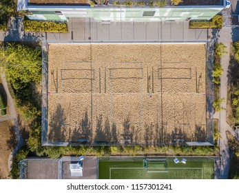 Aerial view of beach volley ball field in morning light during sunrise