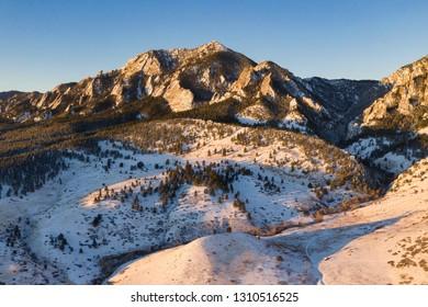 Aerial view of Bear Peak at sunrise during winter in Boulder, Colorado.