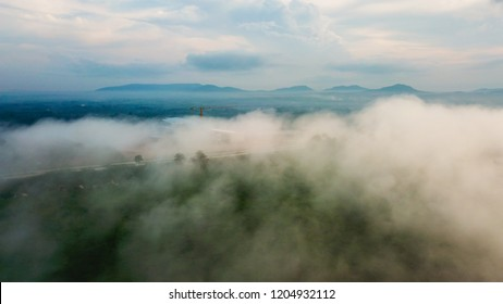 Aerial view  beautiful 4K timelapse misty float through the mountains.