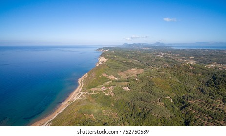 Aerial view of a beautiful bay in south Corfu Greece with crystal clear waters.