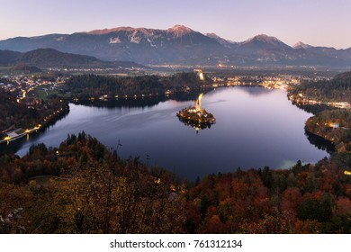 Aerial view of beautiful Bled Lake, Slovenia, at dusk. Mountains on background.