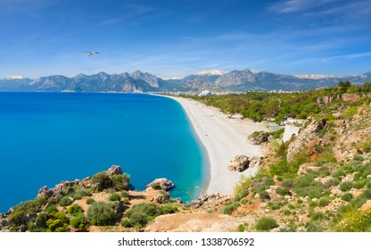 Aerial view of beautiful blue gulf and Konyaalti beach in popular resort city Antalya, Turkey.