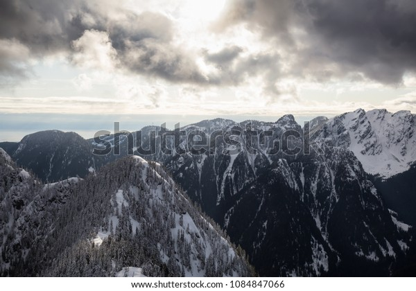 Aerial view of the beautiful Canadian Mountain Landscape during a vibrant cloudy day. Taken North of Vancouver, British Columbia, Canada.