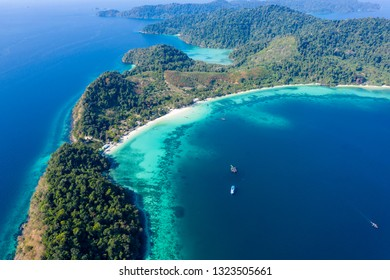 Aerial view of the beautiful coral reef and jungle around the remote Kyun Phi Lar (Greater Swinton) island in the Mergui Archipelago, Myanmar