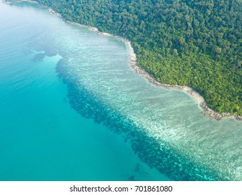 Aerial view of Beautiful coral reef along the tropical island coast with emerald clear water