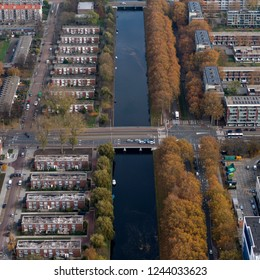 Aerial view of beautiful day in the autumn of 2018 from residential area in the street Louis Bouwmeesterstraat and Johan Huizingalaan in Amsterdam Slotervaart. An indian summer.