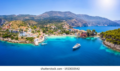 Aerial view to the beautiful fishing village of Assos on the island of Kefalonia, Greece, surrounded by turquoise sea and green hills with Pine Trees