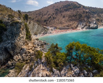 Aerial view of beautiful hidden beach with nature.  Colourful Albanian Riviera