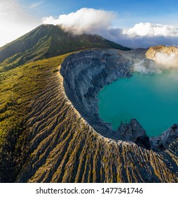 Aerial view of beautiful Ijen volcano with acid lake and sulfur gas going from crater, Indonesia