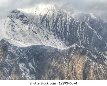 Aerial view of the beautiful intricate and snow-capped mountains On the way from Islamabad to Skardu.scenery of the mountains from the plane window.