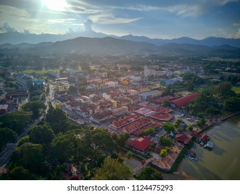 Aerial View of beautiful landscape in Kuala Kangsar city in Malaysia. Buildings on river bank in south east Asia.