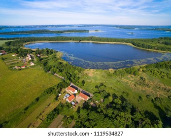 Aerial view of beautiful landscape of lake district, Pniewskie Lake in the foreground, next Mamry Lake and Upalty - the biggest island of Mazury region, Poland