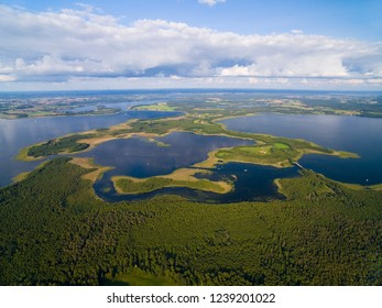 Aerial view of beautiful landscape of lake district, bridge between Dargin and Kirsajty Lakes, Mamry Lake on the left, Swiecajty Lake in the distance, Mazury, Poland