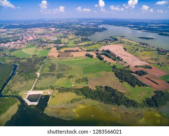 Aerial view of beautiful landscape of lake district, Mamry Lake in the foreground, Swiecajty Lake in the background, Mazury, Poland