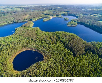 Aerial view of beautiful landscape of Mazury region, Kacze Lake in the foreground, Krzywa Kuta Lake in the background, Poland