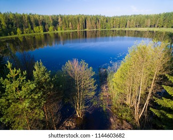 Aerial view of beautiful landscape of Mazury region, small lake in a forest near Ogonki, Poland