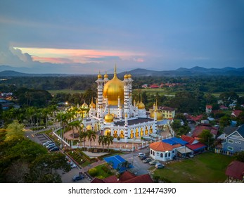 Aerial view of beautiful mosque in Kuala Kangsar, Malaysia during sunset and copy space