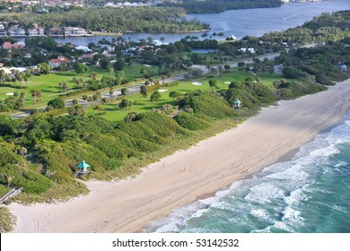 aerial view of beautiful municipal beach and waterfront golf course in south florida