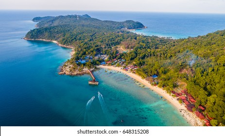 Aerial view of a beautiful Perhentian Islands, Terengganu, Malaysia from a drone with a turqoise blue ocean during sunset
