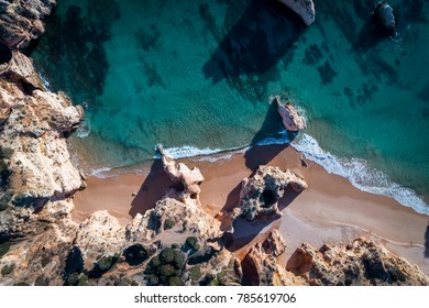 Aerial view of the beautiful Prainha Beach in Portimao, Algarve, Portugal; Concept for travel in Portugal and mos beautiful beaches in Algarve