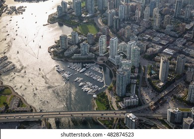 Aerial view of beautiful residential area by the quay in Downtown Vancouver, British Columbia, Canada.