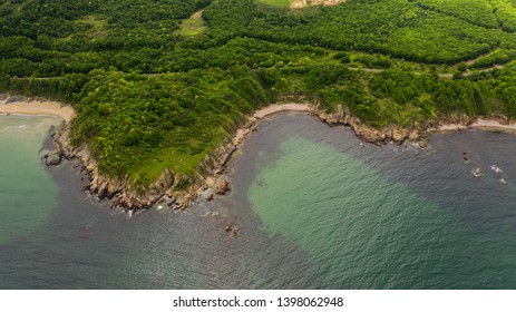 Aerial view of beautiful rocky beach and forest