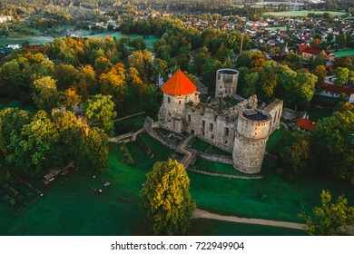 Aerial view of beautiful ruins of ancient Livonian castle in old town of Cesis, Latvia, morning sunrise time