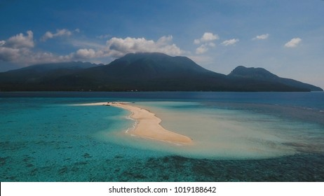Aerial view of beautiful sand tropical island with white sand beach, Camiguin. White sand island. Beautiful beach, sea. Seascape: ocean and beautiful beach paradise. Philippines. Travel concept.