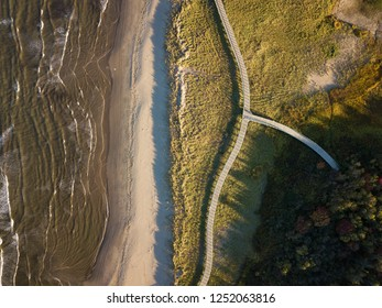 Aerial view of a beautiful sandy beach on the Atlantic Ocean Coast. Taken in La Dune de Bouctouche, New Brunswick, Canada.
