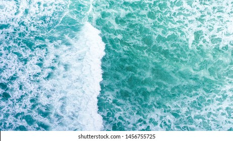 Aerial view beautiful of sea waves from drone. Top view of beautiful white sand beach with turquoise sea water. Tropical beach with sea and palm taken from drone.