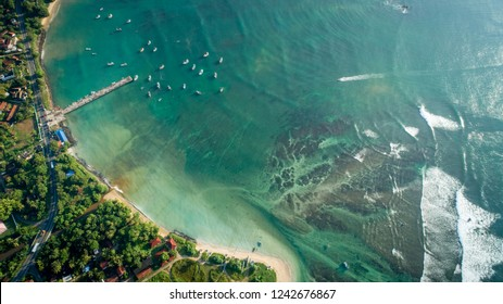 Aerial view of beautiful seascape with fisherman village in sri lanka