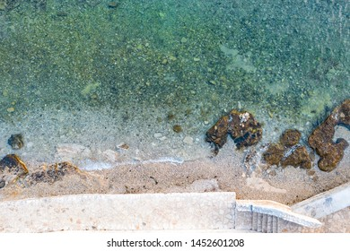 Aerial view of beautiful seaside with beach paths beside the seashore