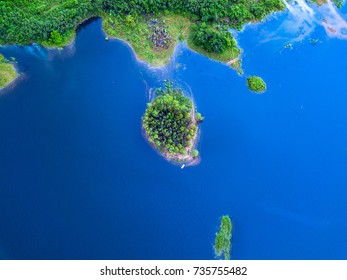 Aerial view of beautiful small island with deep blue ocean.