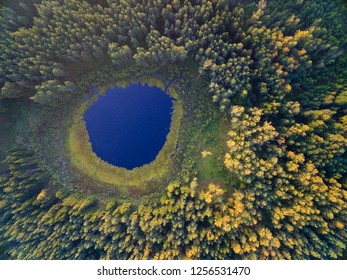 Aerial view of beautiful small lake in the forest, Mazury, Poland